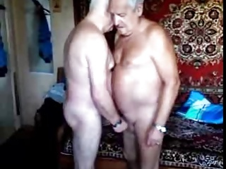 Two grandpas sucking each other