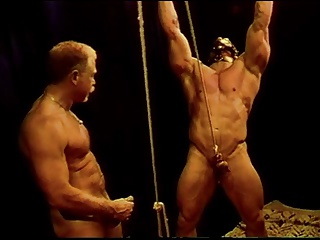 I have a huge bodybuilder in bondage while I bash his balls.